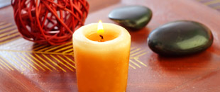 Beeswax candle on coffee table